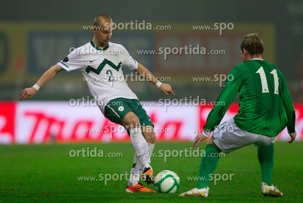 Miso Brecko of Slovenia vs Grant McCann of Northern Ireland during EURO 2012 Quaifications game between National teams of Slovenia and Northern Ireland, on March 29, 2011, in Windsor Park Stadium, Belfast, Northern Ireland, United Kingdom. (Photo by Vid Ponikvar / Sportida)