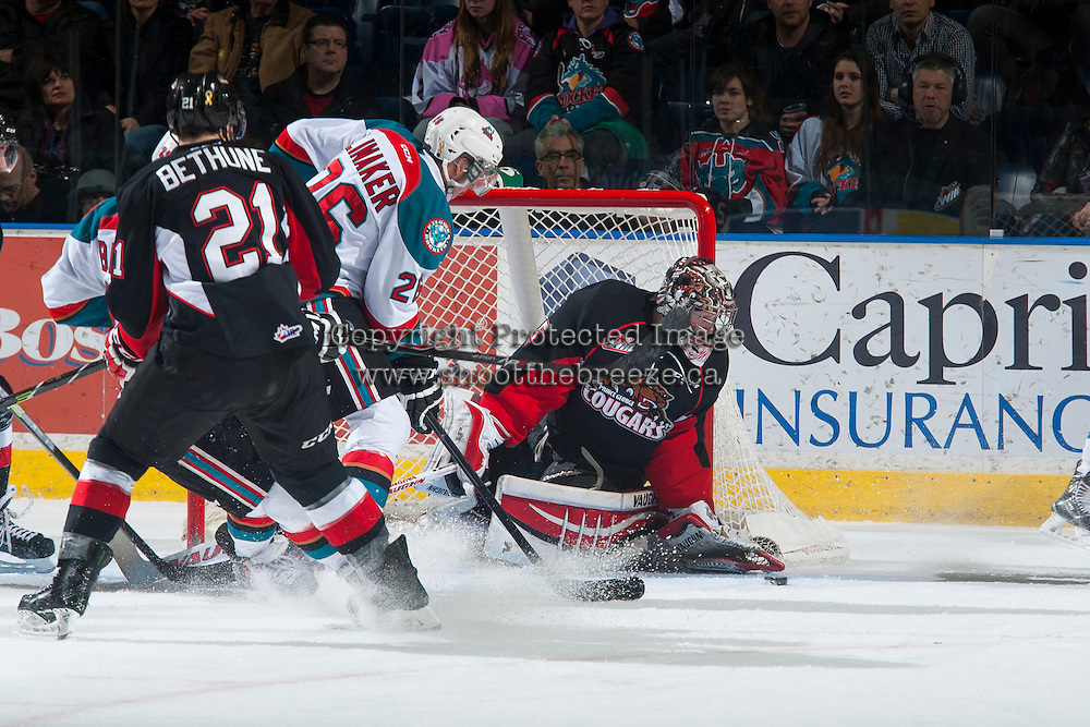 KELOWNA, CANADA - DECEMBER 30: Ty Edmonds #35 of Prince George Cougars makes a save against the Kelowna Rockets on December 30, 2014 at Prospera Place in Kelowna, British Columbia, Canada.  (Photo by Marissa Baecker/Shoot the Breeze)  *** Local Caption *** Ty Edmonds;