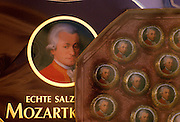 Image of a storefront with Mozart chocolates in Old Town Salzburg, Austria