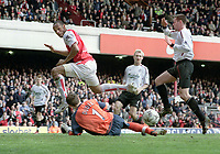 Fotball<br /> NORWAY ONLY<br /> Foto: Andrew Cowie, Digitalsport<br /> <br /> Goal 3 :Thierry Henry (Arsenal) scores his hat trick with Arsenal's 4th goal, past Jamie Carragher and Jerzy Dudek (Liv). Arsenal v Liverpool. 19/4/2004.
