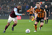 Aston Villa midfielder Lewis Grabban (45) beats Hull City defender Max Clark (24)  during the EFL Sky Bet Championship match between Hull City and Aston Villa at the KCOM Stadium, Kingston upon Hull, England on 31 March 2018. Picture by Mick Atkins.