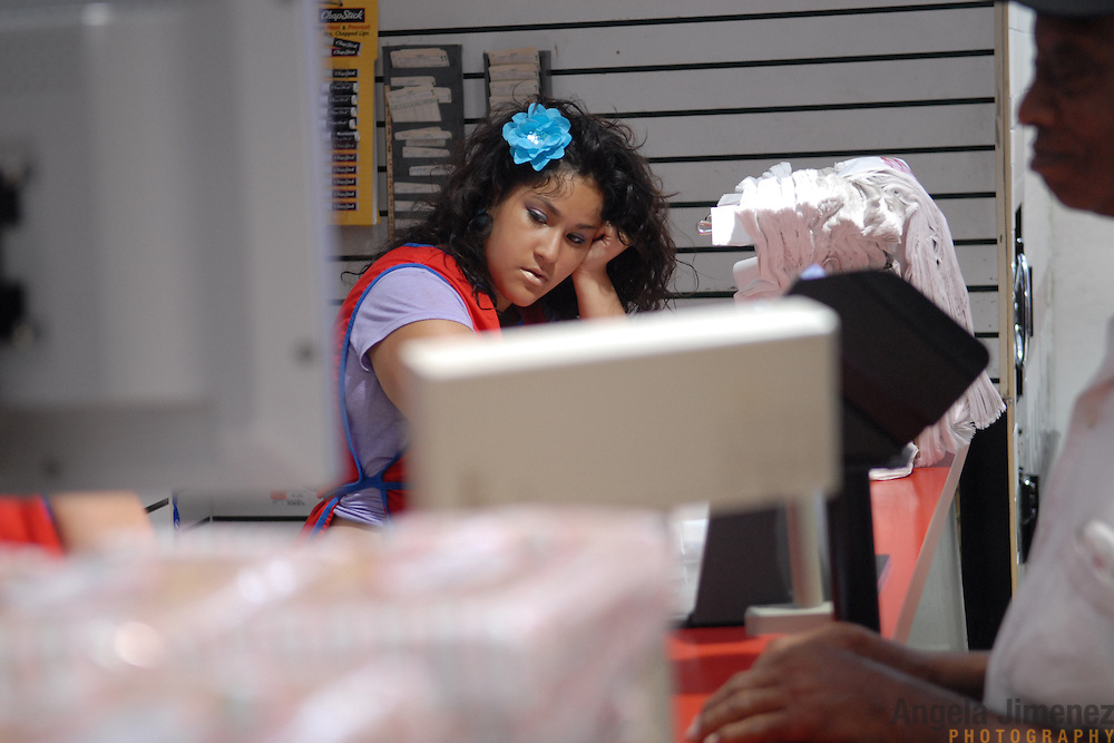 DATE: 6/8/07<br /> DESK: CTY<br /> SLUG: CTOWN<br /> ASSIGN ID: 30044113A<br /> <br /> Krystal Leon, 17, waits for the next customer while bagging groceries during her cashier shift at Steve's C-Town, a grocery store on 9th Street between 5th and 6th Avenues in Park Slope, Brooklyn on June 8, 2007. <br /> <br /> photo by Angela Jimenez for The New York Times<br /> photographer contact 917-586-0916