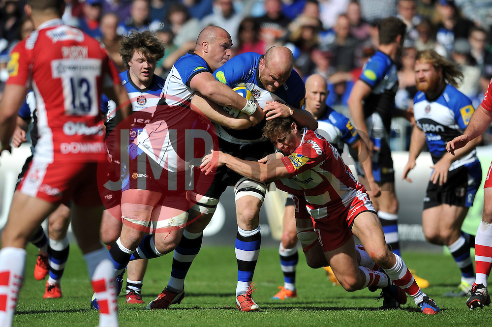 Matt Garvey of Bath Rugby takes on the Gloucester defence - Photo mandatory by-line: Patrick Khachfe/JMP - Mobile: 07966 386802 16/05/2015 - SPORT - RUGBY UNION - Bath - The Recreation Ground - Bath Rugby v Gloucester Rugby - Aviva Premiership