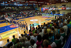 Teams listening to the national anthems during friendly match between National teams of Slovenia and Ukraine for Eurobasket 2013 on July 26, 2013 in Dvorana Komunalnega centra, Domzale, Slovenia. Slovenia defeated Ukraine 74-46. (Photo by Vid Ponikvar / Sportida.com)