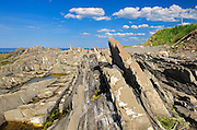 Rocky shoreline on the Gulf of St. Lawrence<br /> Pointe_A-La-Fregate<br /> Quebec<br /> Canada
