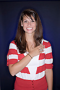 teenage girl being happy and patriotic with her hand on her heart and smiling.Model Released