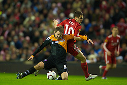 LIVERPOOL, ENGLAND - Wednesday, December 15, 2010: Liverpool's Joe Cole and FC Utrecht's Michael Silberbauer during the UEFA Europa League Group K match at Anfield. (Photo by: David Rawcliffe/Propaganda)