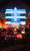 Night on South Beach's neon-lit Ocean Drive -- with motorcycles and the Art Deco-style Colony Hotel, designed by Henry Hohauser in 1935.