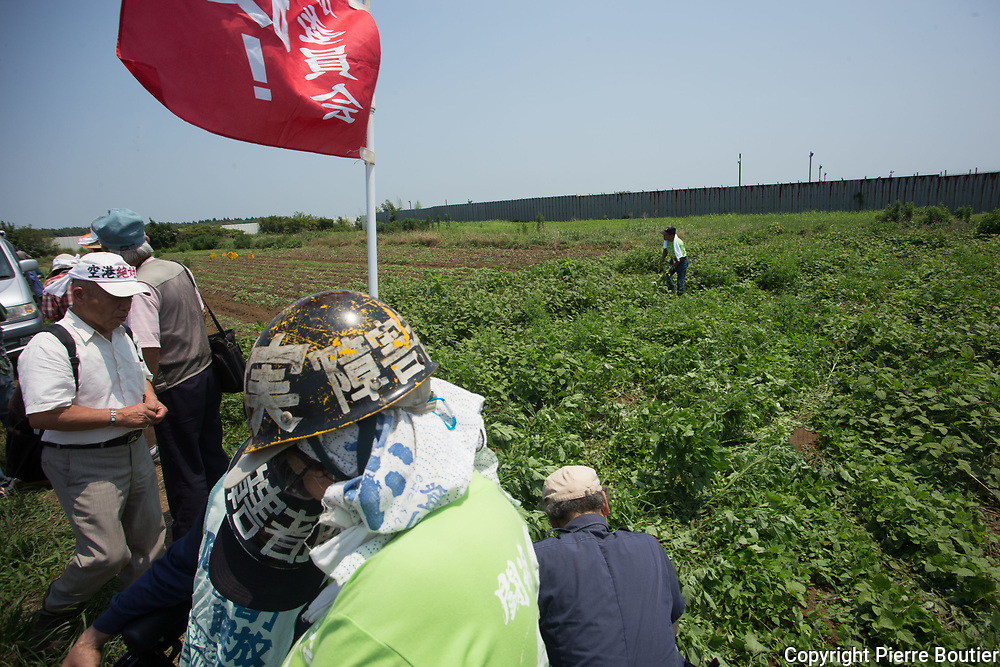 July 9,2017_Tokyo,Chiba   farmers and revolutionnary leagues fighting against the expropriation of their land by Narita airport company who want to expand the land of airport . 50 years after the first actions of resistance, and a long  struggle where there were more than 6500 wounded and 3300 arrests and two deaths in confrontations with the police anti Riots, groups from the new left, such as the Zengakuren, the farmers' league, the communist league, anarchist groups are gathering on the plots of Sir Takao Ito who continues to fight against his expropriation. Pierre Boutier