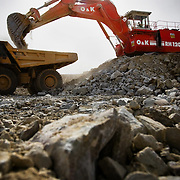 An excavator loads a large truck with ore in the main pit of the Youga gold mine near the town of Youga, approximately 205 km southeast of Burkina Faso's capital Ouagadougou on Tuesday April 28, 2009..