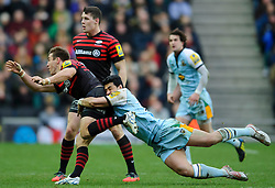 Saracens Full Back (#15) Chris Wyles is tackled by Northampton Outside Centre (#13) George Pisi during the first half of the match - Photo mandatory by-line: Rogan Thomson/JMP - Tel: Mobile: 07966 386802 30/12/2012 - SPORT - RUGBY - stadiummk - Milton Keynes. Saracens v Northampton Saints - Aviva Premiership.