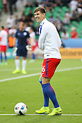England Defender John Stones in warm up during the Euro 2016 Group B match between Slovakia and England at Stade Geoffroy Guichard, Saint-Etienne, France on 20 June 2016. Photo by Phil Duncan.