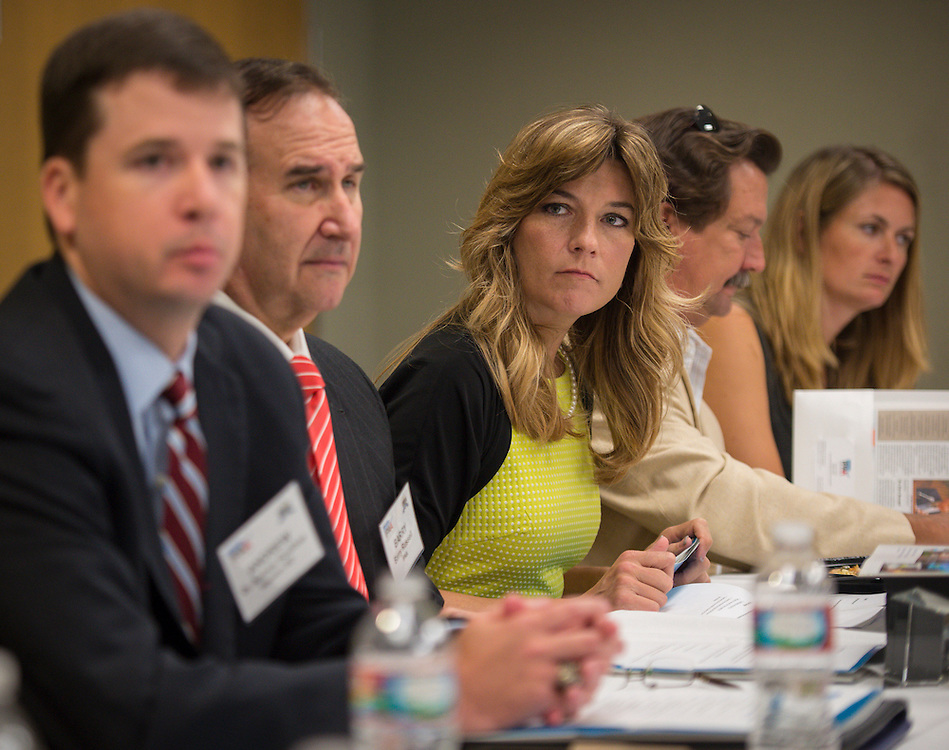 Energy Institute High School principal Lori Lambropoulos listens to comments during the first meeting of the school's Advisory Board, August 14, 2013.
