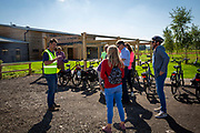 A tour guide gives a talk to a group of people as they arrive on their bikes at at Hush Heath Winery, Staplehurst, Kent, England, UK (photo by Andrew Aitchison / In pictures via Getty Images)