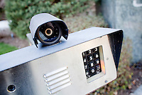 9 April, 2009. Brookville, NY. A security camera and entry phone are here at the entrance of a residence on Evans Drive in Brookville, NY. The majority of the residences in Brookville have security systems. The Gold Coast village of Brookville is the wealthiest community in the United States, according to a survey published Wednesday by BusinessWeek magazine.<br /> <br /> Brookville was one of nine Long Island communities to make the magazine's list of the country's 25 wealthiest towns, based on research by the Gadberry Group, of Little Rock, Ark.<br /> <br /> The village's mayor, Caroline Zimmermann Bazzini, said Brookville residents likely felt the pain of recession much less than most other folks.<br /> <br /> Brookville residents had the highest average net worth of any town on the list: $1.67 million. The enclave's well-to-do denizens had an average annual income of $328,000, ranking it seventh on the list.<br /> <br /> ©2009 Gianni Cipriano<br /> cell. +1 646 465 2168 (USA)<br /> cell. +1 328 567 7923 (Italy)<br /> gianni@giannicipriano.com<br /> www.giannicipriano.com