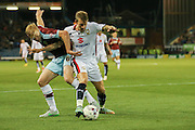 Milton Keynes Dons midfielder Carl Baker tries to get past Burnley defender Ben Mee during the Sky Bet Championship match between Burnley and Milton Keynes Dons at Turf Moor, Burnley, England on 15 September 2015. Photo by Simon Davies.