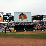 Masahiro Tanaka, New York Yankees, on the stadium screen helping fans with Japanese language lessons as Derek Jeter warms up before the New York Yankees V Baltimore Orioles home opening day at Yankee Stadium, The Bronx, New York. 7th April 2014. Photo Tim Clayton