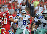 KANSAS CITY, MO - SEPTEMBER 15:  Quarterback Tony Romo #9 of the Dallas Cowboys hurries his throw against pressure from defensive end Mike DeVito #70 of the Kansas City Chiefs during the first half on September 15, 2013 at Arrowhead Stadium in Kansas City, Missouri.  Kansas City defeated Dallas 17-16. (Photo by Peter Aiken/Getty Images) *** Local Caption *** Tony Romo