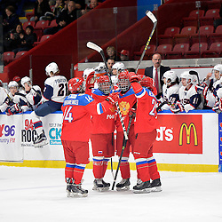WHITBY, - Dec 17, 2015 -  Game #10 - United States vs. Russia at the 2015 World Junior A Challenge at the Iroquois Park Recreation Complex, ON. Players from Team Russia celebrate the goal by Mikhail Meshcheryakov #25 during the first period.<br /> (Photo: Shawn Muir / OJHL Images)