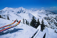 Two pairs of skis on edge of ski run