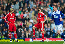 BIRMINGHAM, ENGLAND - Sunday, April 4, 2010: Liverpool's Fernando Torres and captain Steven Gerrard MBE look dejected as they kick off after Birmingham City score the equalising goal during the Premiership match at St Andrews. (Photo by David Rawcliffe/Propaganda)