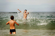 Bogdan Tymchenko, Sergii Karas 12 and 14 having fun at the beach. Since he came to Portugal in 2010 and he saw the sea for the first time, he learned to swim and to surf and spends the most of his time inside water.