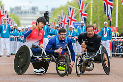 © Licensed to London News Pictures. 28/04/2019. London, UK.  Japan's Tomoki Suzuki (L), American Daniel Romanchuk  (C) and Switzerland's Marcel Hug (R) winners of the men's wheelchair race at the London Marathon 2019. Photo credit: Dinendra Haria/LNP