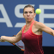 Simona Halep, Romania, in action against Victoria Azarenka, Belarus, in the Women's Singles Quarterfinals match during the US Open Tennis Tournament, Flushing, New York, USA. 9th September 2015. Photo Tim Clayton