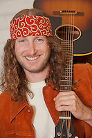 Portrait of smiling mid adult man with guitar