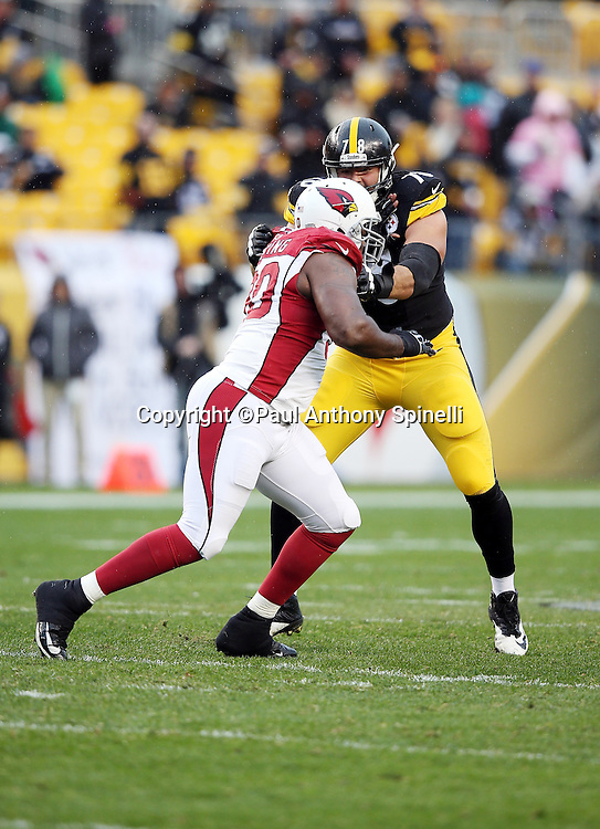Pittsburgh Steelers tackle Alejandro Villanueva (78) blocks Arizona Cardinals defensive end Cory Redding (90) during the 2015 NFL week 6 regular season football game against the Arizona Cardinals on Sunday, Oct. 18, 2015 in Pittsburgh. The Steelers won the game 25-13. (©Paul Anthony Spinelli)