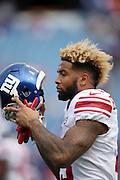 New York Giants wide receiver Odell Beckham Jr. (13) sports a blonde hairdo as he puts on his helmet during the 2015 NFL week 4 regular season football game against the Buffalo Bills on Sunday, Oct. 4, 2015 in Orchard Park, N.Y. The Giants won the game 24-10. (©Paul Anthony Spinelli)