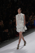An off-white short set with a sleeveless jacket with lapels by Richard Chai at the Spring 2013 Mercedes Benz Fashion Week show in New York.