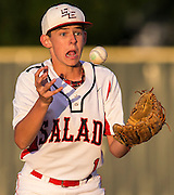 Salado's Cody Wolf bobbles the ball as he prepares to throw to first base during game action of a 2A regional quarterfinal against Clifton at the University of Mary Hardin-Baylor baseball field in Belton on Thursday, May 15, 2014.