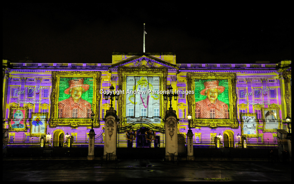 Buckingham Palace lit up by huge Queen image made from childrens self-portraits. More than 200,000 childrens self-portraits have been used to create a giant image of the Queen, which is being projected on to Buckingham Palace, Thursday April 19, 2012. Photo By Andrew Parsons/I-images