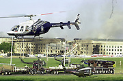 September 11, 2001_ The Pentagon, Washington, DC.Rescue efforts continue into the afternoon at the Pentagon building with various agency and police resorces coming to the scene..(C) 2001 Sandy Schaeffer / MAI / TimePix