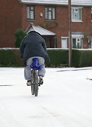 © Licensed to London News Pictures. 05/12/2012..Cleveland, England..A man makes his way home along a snow covered road after overnight snow fall brings the first signs of the wintery weather that is forecast for the rest of this week to parts of East Cleveland...Photo credit : Ian Forsyth/LNP