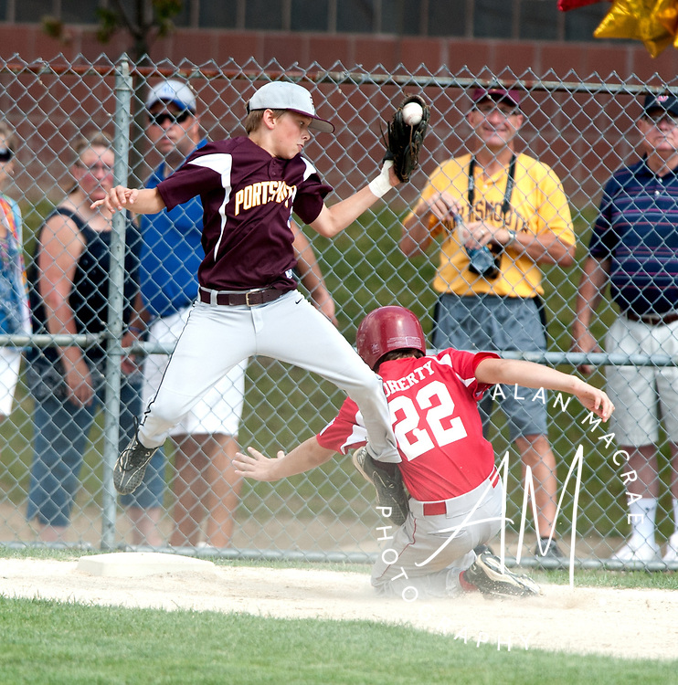 Portsmouth's Liam McCaffinn leaps for the catch as Laconia's Connor Doherty slides into third base in game one of the 11 & 12 year old all stars at Laconia's Colby Field on Saturday, July 17, 2010.  (Alan MacRae/for the Citizen)