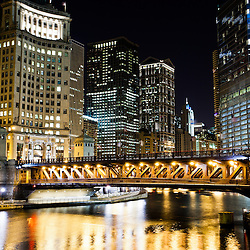 Chicago Dusable Bridge (formerly Michigan Avenue Bridge) and downtown Chicago loop buildings along the Chicago River.