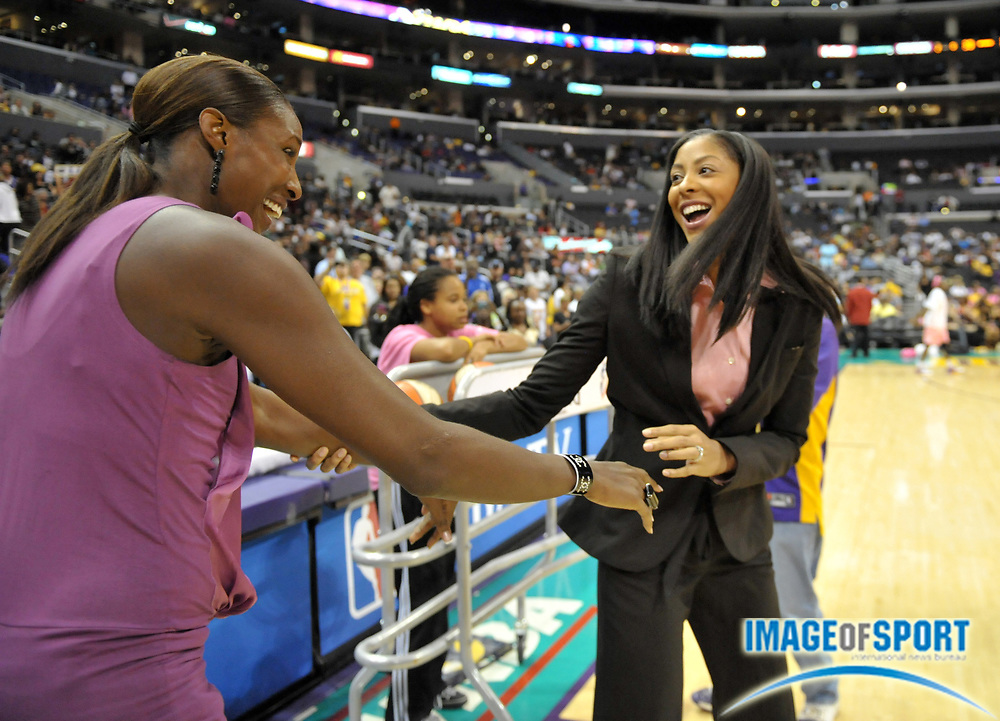 Aug 10, 2010; Los Angeles, CA, USA; Los Angeles Sparks player Candace Parker (right) congratulates former player Lisa Leslie (left) after Leslie's No. 9 jersey was retired at halftime of the WNBA game against the Indian Fever at the Staples Center. Photo by Image of Sport