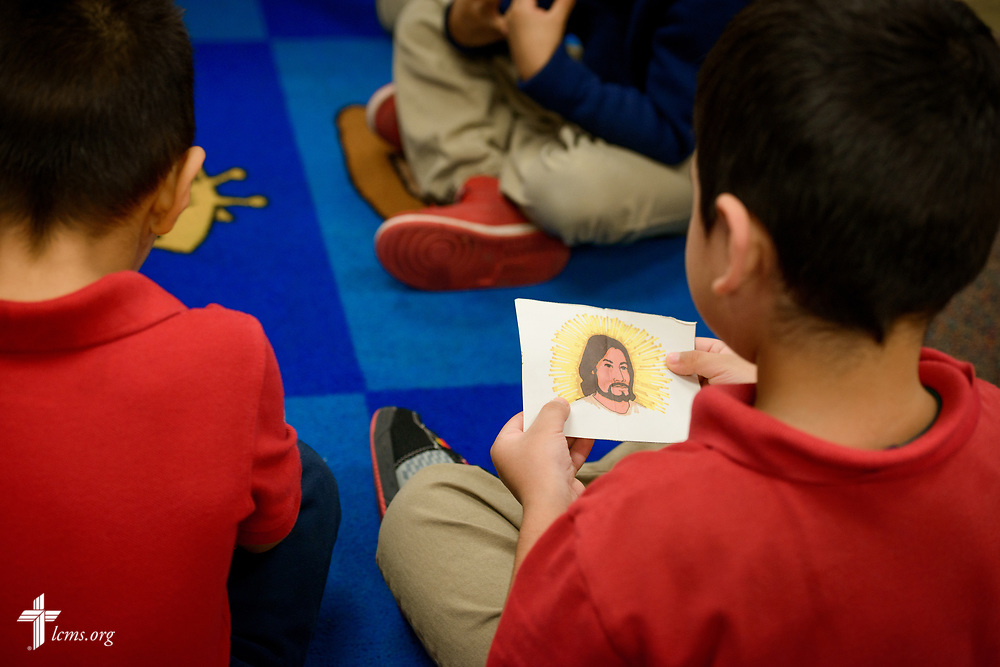 Preschool students in Linda Proeber's class pass around an image depicting Jesus Christ during an activity at St. Martini Lutheran School on Tuesday, Nov. 14, 2017, in Milwaukee. LCMS Communications/Erik M. Lunsford