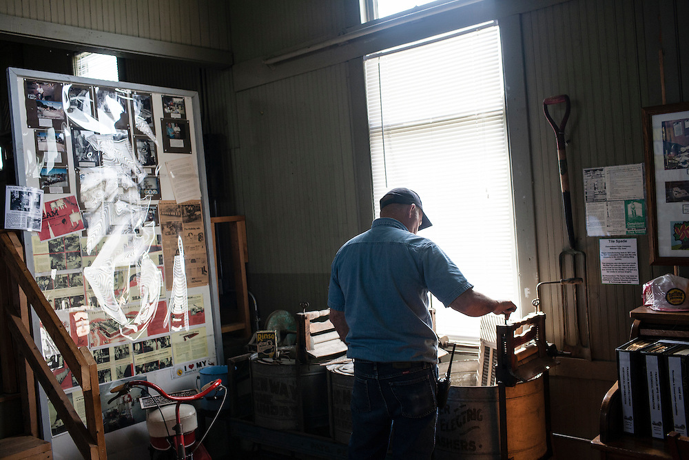 A city worker examines objects in the local museum on Friday, March 23, 2012 in Webster City, IA.