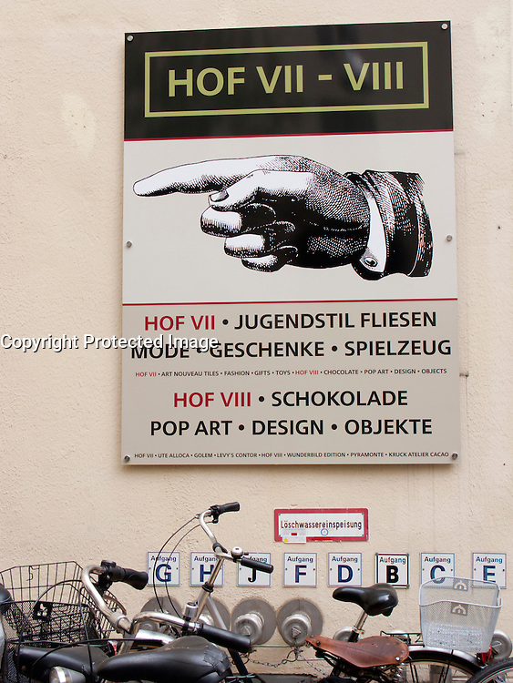 Information sign at famous Hackesche Hofe historic courtyards in Mitte Berlin Germany