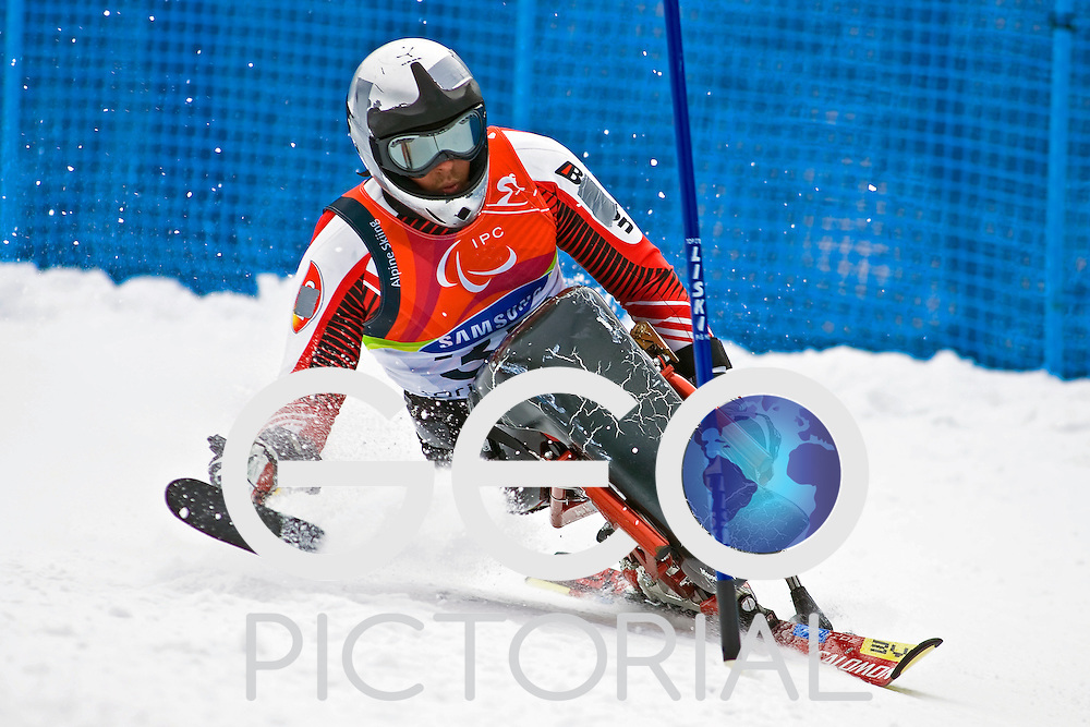 SESTRIERE COLLE, ITALY - MARCH 19th : Harald Eder of Austria in the mens Alpine Skiing Slalom Sitting competition on Day 10 of the 2006 Turin Winter Paralympic Games on March 19th, 2006 in Sestriere Borgata, Italy.