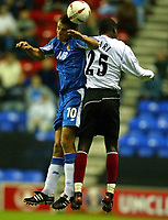 Photo. Aidan Ellis.<br />Wigan Athletic v Fulham.<br />Carling Cup 2nd Round.<br />23/09/2003.<br />Wigan's Lee McCulloch and Fulham's Malik Buari