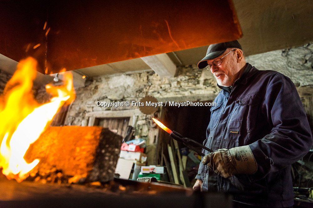 Herrstein, Nahetal, Germany, May 2018. A professional Blacksmith. Traditional homes in the historical centre of medieval town Herrstein. The Nahe region is named after the river that traverses the valleys of the forested Hunsrück Hills as it flows towards the Rhine. A landscape of vineyards, orchards and meadows interspersed with cliffs and striking geological formations. Photo by Frits Meyst / MeystPhoto.com