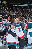 KELOWNA, CANADA - MAY 13: Brothers Josh Morrissey #27 and Jake Morrissey #31 of Kelowna Rockets celebrate the WHL Championship win against the Brandon Wheat Kings on May 13, 2015 during game 4 of the WHL final series at Prospera Place in Kelowna, British Columbia, Canada.  (Photo by Marissa Baecker/Shoot the Breeze)  *** Local Caption *** Josh Morrissey; Jake Morrissey;