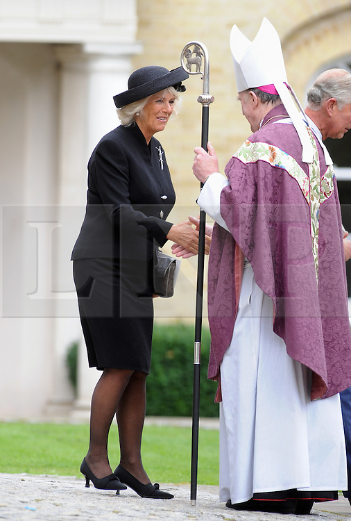 © Licensed to London News Pictures. 11/09/2013<br /> Camilla after the service.<br /> Leaving the Cathedral after the Mass.<br /> Funeral for Hugh Van Cutsem at Brentwood Cathedral,Essex.<br /> Prince of Wales,Duke of Cambridge and Prince Harry in attendance today (11.09.2013)<br /> Photo credit :Grant Falvey/LNP