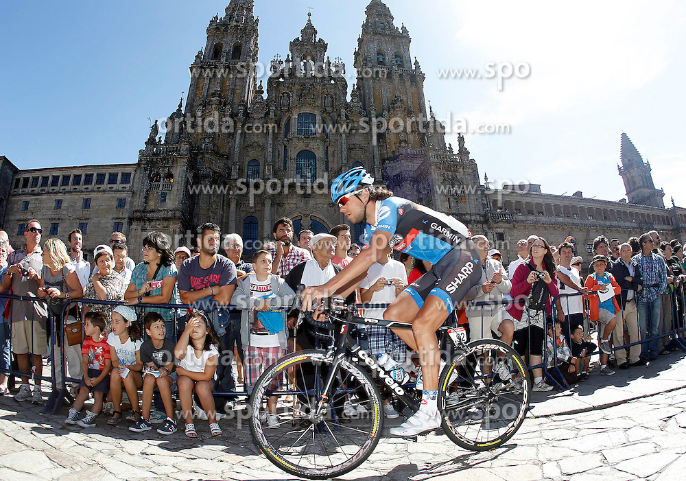 31.08.2012, 13. Etappe, Santiago de Compostella nach Ferrol, ESP, La Vuelta, im Bild Thomas Dekker passes by the front of the Obradoiro of the Cathedral of Santiago de Compostela // before the La Vuelta, Stage 13 Santiago de Compostella to Ferrol, Spain on 2012/08/31. EXPA Pictures © 2012, PhotoCredit: EXPA/ Alterphotos/ Acero..***** ATTENTION - OUT OF ESP and SUI *****