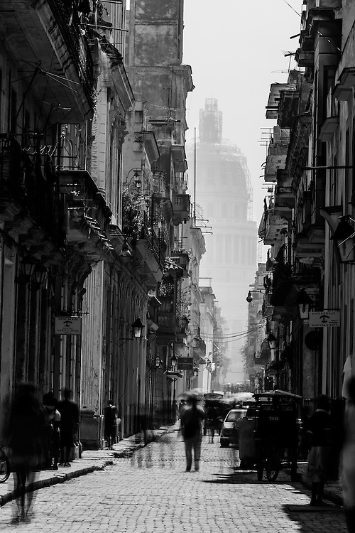 Where, Havana, Cuba.<br /> One of my best loved images. I think its to do with the contrast of light and shadow and the blur of the people. Fantastic shot.