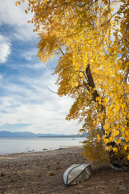 """Lake Tahoe in Autumn 2"" - This boat on the shore was photographed near some yellow cottonwood trees in the fall at Lake Tahoe."